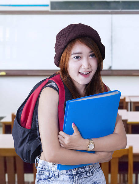 Student holding a portfolio