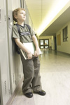 Boy leaning on lockers