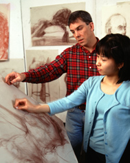 eacher helping student in drawing class
