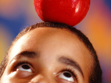 Apple on boy's head