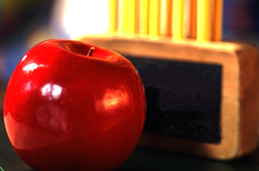 Red apple and pencils