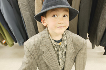 Boy playing dress up