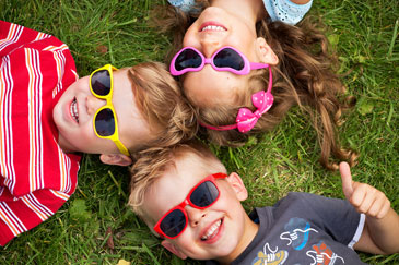 Cheerful Kids Wearing Sunglasses Outside