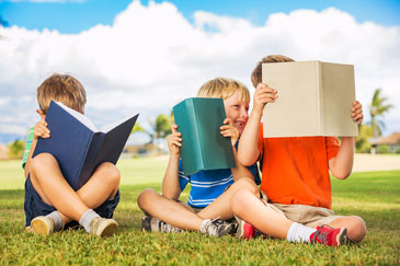 Happy Kids Reading Books Outside