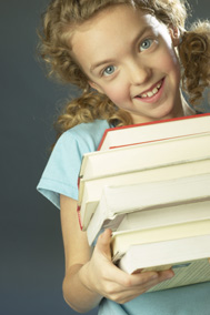 Young girl carrying books
