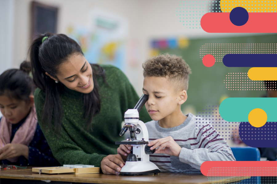 A student at a microscope with teacher assisting