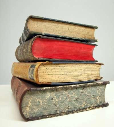 stack of hard bound books